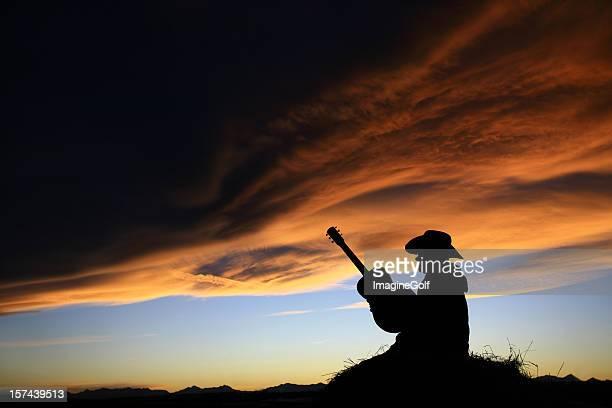 Cowboy en Silhouette de la guitare