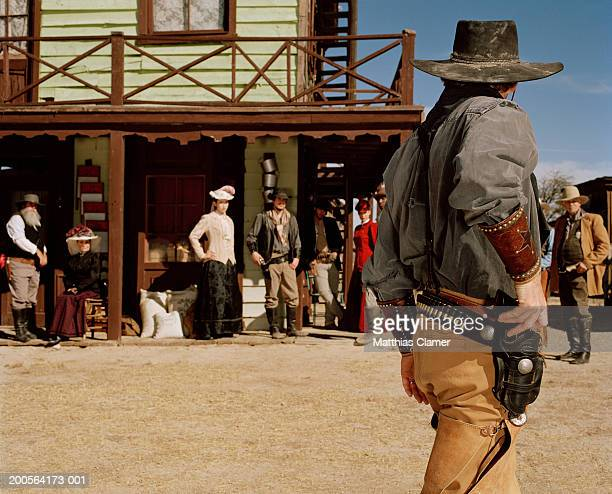 Cowboy with gun in old west town