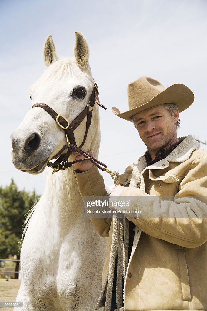 Cowboy with horse : Stock Photo