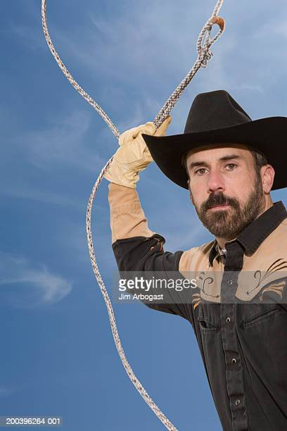 Cowboy with lasso rope, low angle view