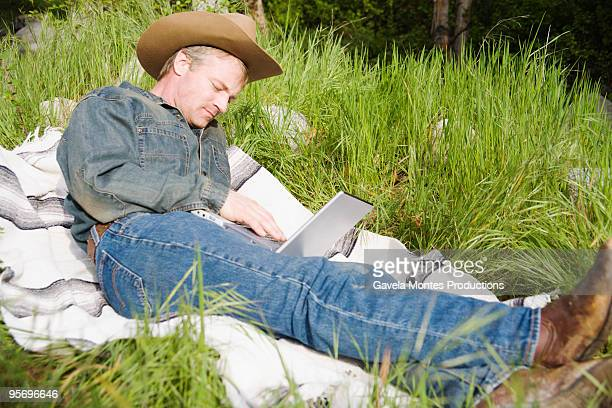 Cowboy working on laptop computer