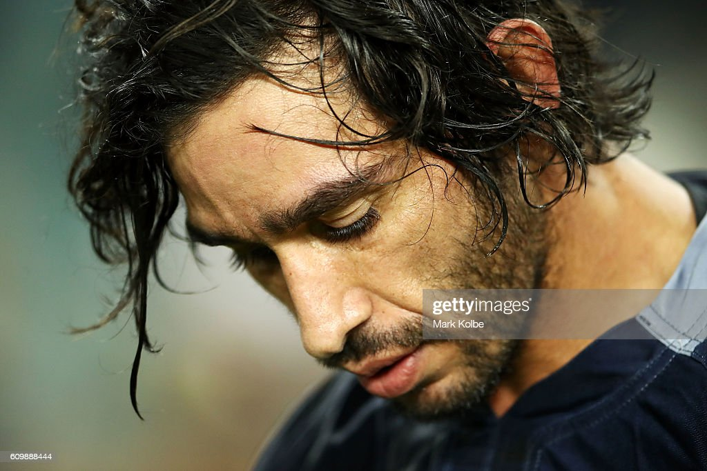 Cowboys captain Johnathan Thurston looks dejected after losing the NRL Preliminary Final match between the Cronulla Sharks and the North Queensland Cowboys at Allianz Stadium on September 23, 2016 in Sydney, Australia.