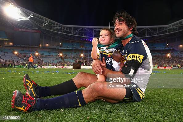 Cowboys captain Johnathan Thurston takes a moment in the centre of the field with his daughter Frankie Thurston after winning the 2015 NRL Grand...