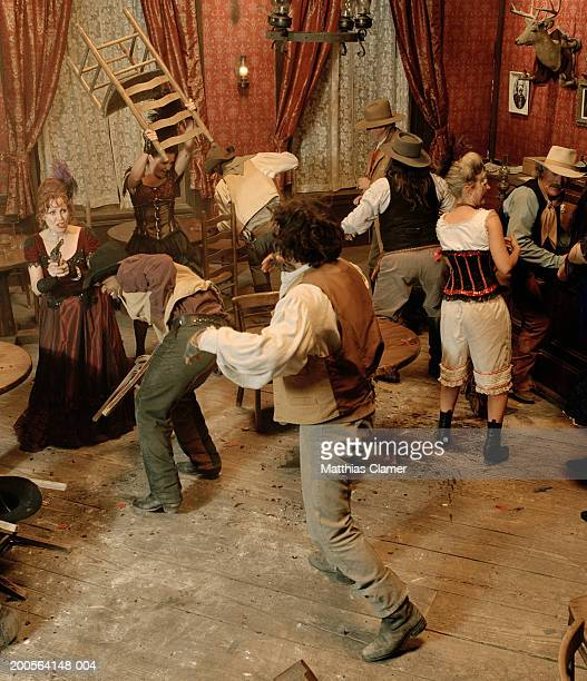 Cowboys fighting in saloon