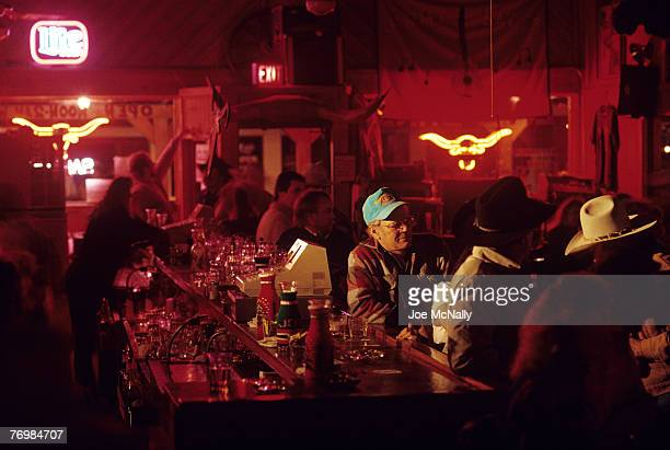 Cowboys hang out at a local bar after a long day on the range in 1996 at the Double Mountain River Ranch outside Rotan TX Cowboy life in 1996 was...