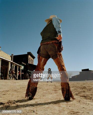 Cowboys having gun duel in old west town