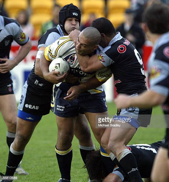 Cowboys Paul Rauhihi is taken in a high tackle from Warriors Monty Betham and Evarn Tuimavave a penalty was given for this tackle in extra time to...