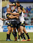 Cowboys players celebrate after Johnathan Thurston kicks a field goal to win the round 15 NRL match between the Canberra Raiders and the North...