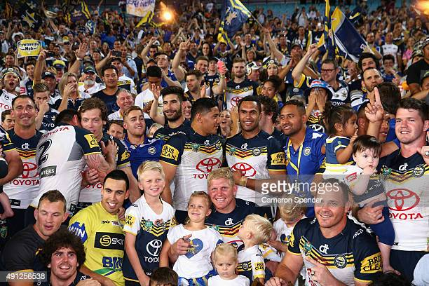Cowboys players pose with fans after winning the 2015 NRL Grand Final match between the Brisbane Broncos and the North Queensland Cowboys at ANZ...