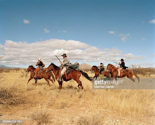 Cowboys riding on horses