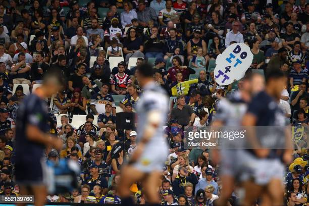 Cowboys supporters holds up a sign for Johnathan Thurston during the NRL Preliminary Final match between the Sydney Roosters and the North Queensland...