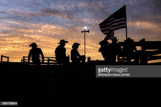 TOPSHOT Cowboys wait for another round during a rodeo at the Shenandoah County Fair September 2 2016 in Woodstock Virginia / AFP PHOTO / Brendan...