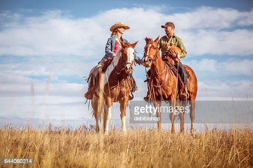 Cowgirl And Cowboy In Love On Horseback