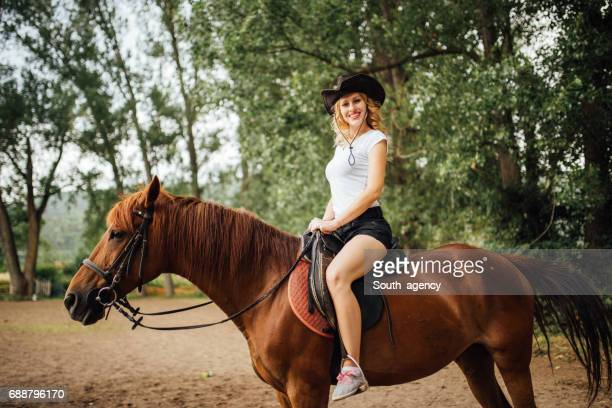 Cowgirl on a brown horse