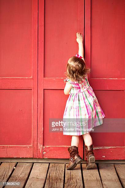 Cowgirl on a Red Door