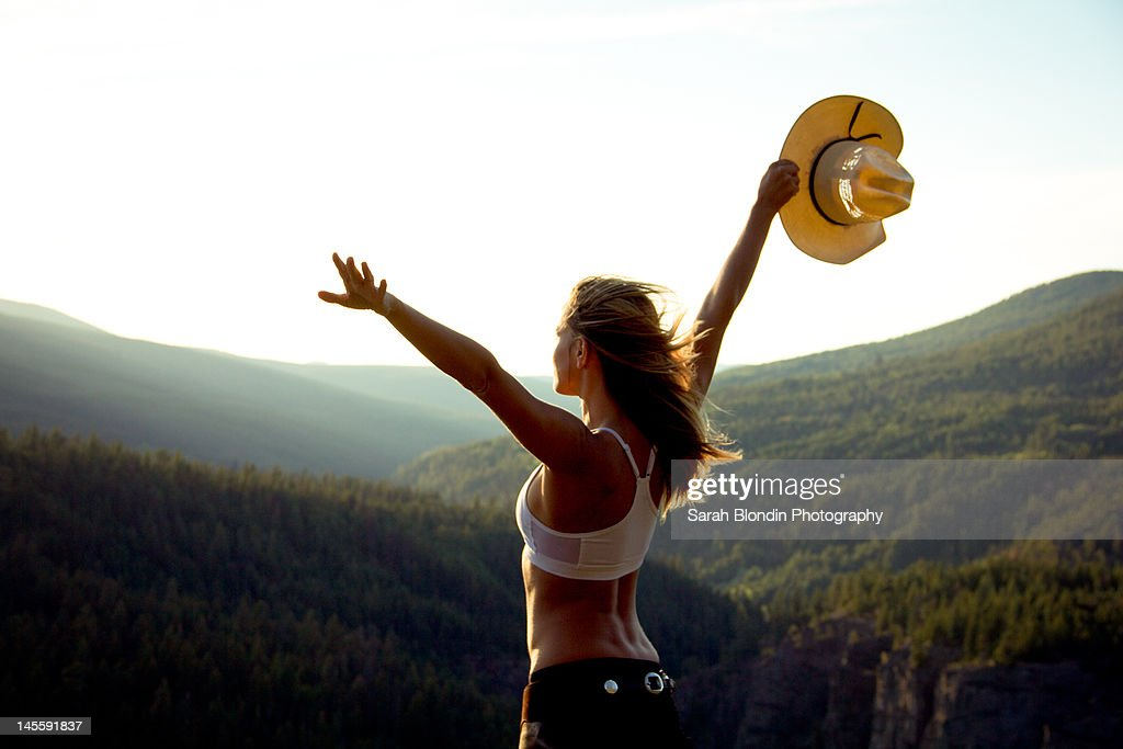 Cowgirl on top of mountain : Stock Photo