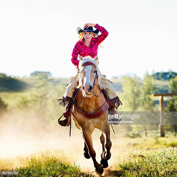 Cowgirl riding fast