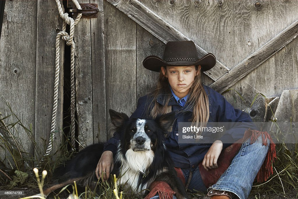 Cowgirl with dog : Stock Photo