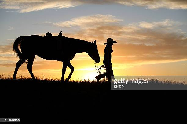 cowgirlwalking her horse