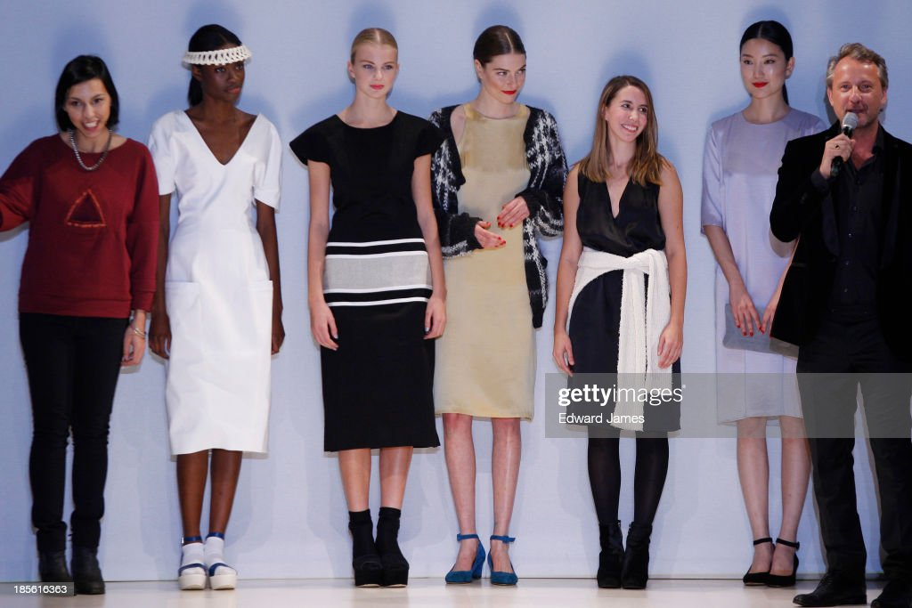 Co-Winners Cecile Raizonville of Matiere Noire (L) and Malorie Urbanovitch (3rd from R) take a bow during the Mercedes-Benz Startup Finals fashion show at David Pecaut Square on October 22, 2013 in Toronto, Canada.