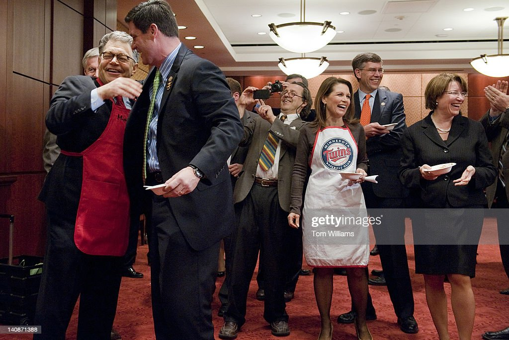 Co-winners Sen. Al Franken, D-Minn., left, hugs Rep. Chip Cravaack, R-Minn., as Rep. Michele Bachmann, R-Minn., in apron, Sen. Amy Klobuchar, D-Minn., and Rep. Erik Paulsen, R-Minn., applaud during the second annual 'hotdish' competition in the Capitol Visitor Center, featuring casserole-like dishes from members of the Minnesota Congressional Delegation. The dishes of Sen. Franken and Rep. Chip Cravaack, R-Minn., tied for first place in the competition.