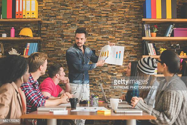 Coworkers analyzing data chart in the office