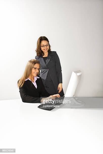 Coworkers at computer