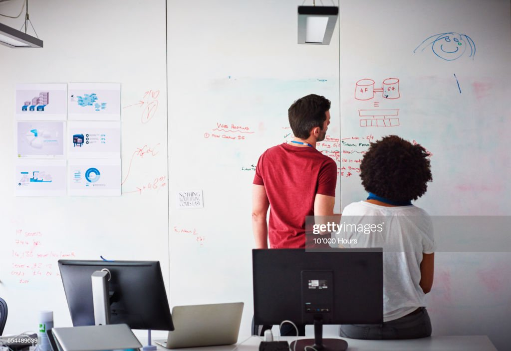 Coworkers brainstorming in a start-up office