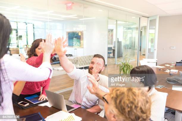 Coworkers Celebrating with a High-Five
