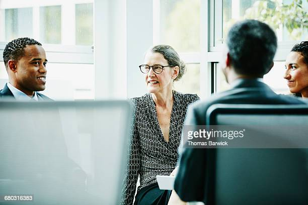 Coworkers discussing team project