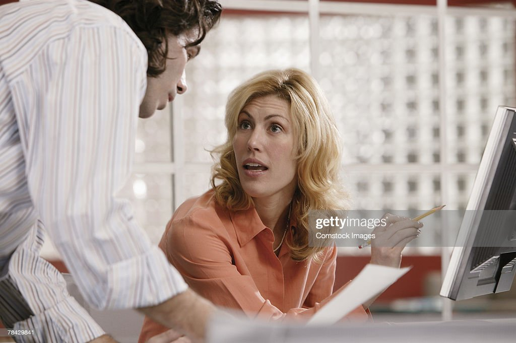 Coworkers discussing work : Stock Photo