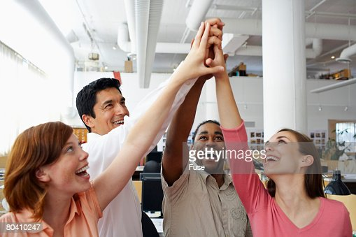Coworkers Giving High-Five