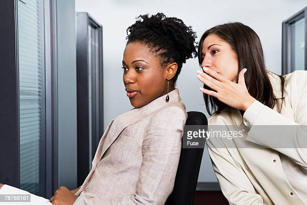 Co-Workers Gossiping in Office