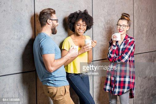 Coworkers having a coffee break : Stock Photo