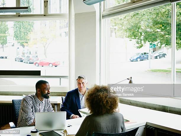 Coworkers having informal project meeting