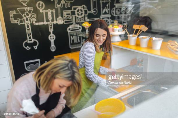 Coworkers in cake shop