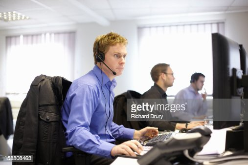 Coworkers in call centre office : Stock Photo
