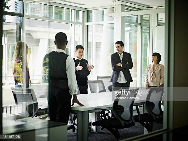 Coworkers in conference room in discussion