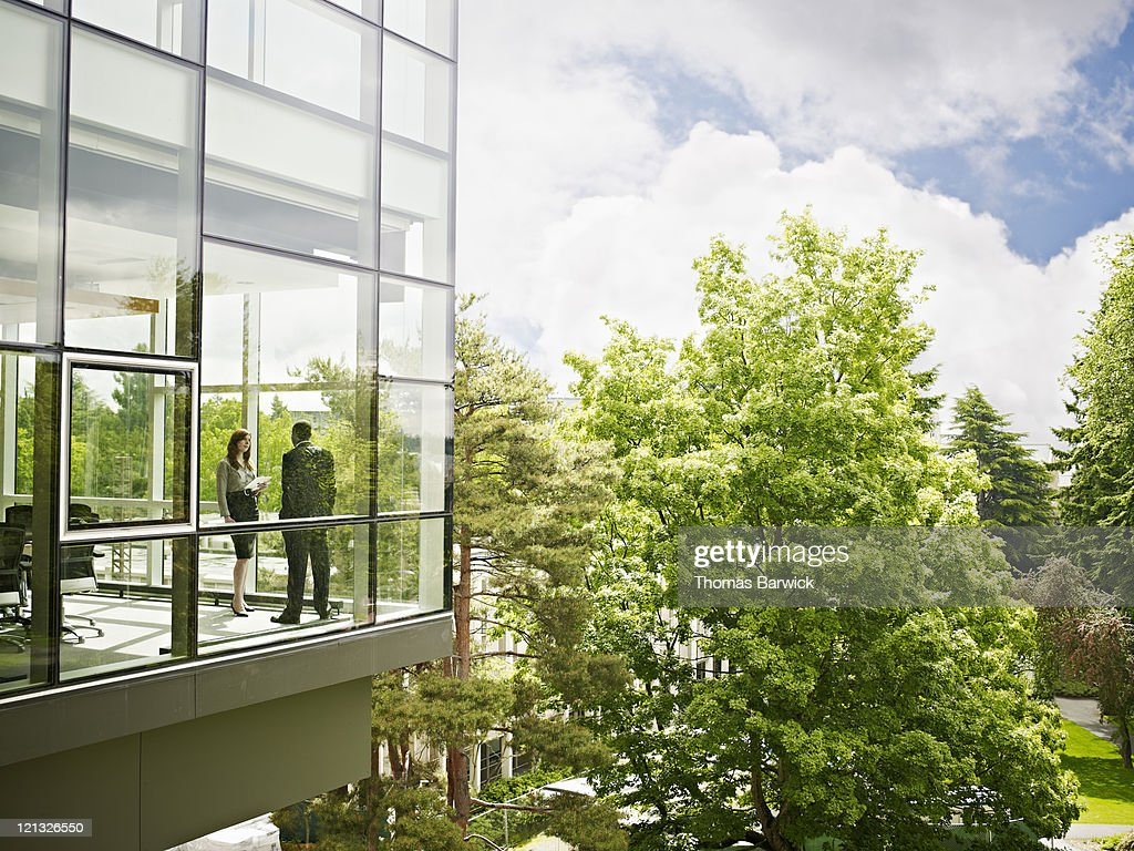Coworkers in conference room view from outside : Stock Photo