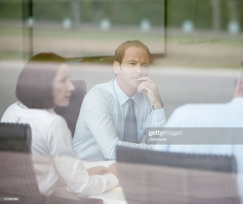 Coworkers in discussion at conference room : Stock Photo