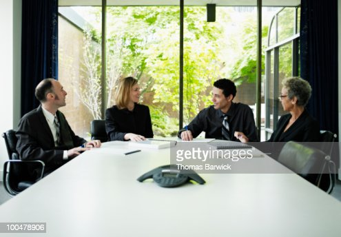 Coworkers in discussion at conference table : Stock Photo
