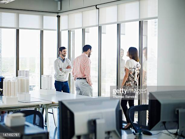 Coworkers in discussion in architects office