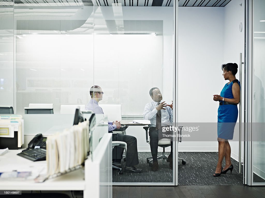 Coworkers in discussion in office conference room : Stock Photo