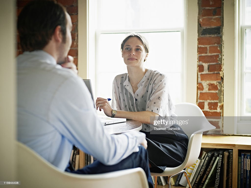 Coworkers in discussion in office : Stock Photo
