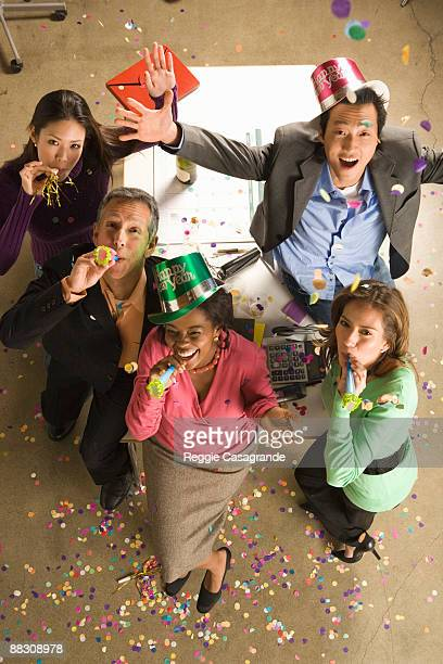 Co-workers  in office celebrating New Year's Eve party