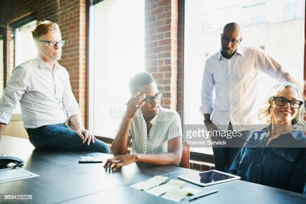 Coworkers in project planning meeting in office conference room