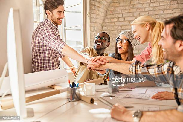 Coworkers joining hands