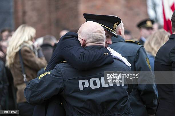 Coworkers of the murdered Danish police officer Jesper Jul comfort each other following the state funeral of the policeman at Roskilde Cathedral on...