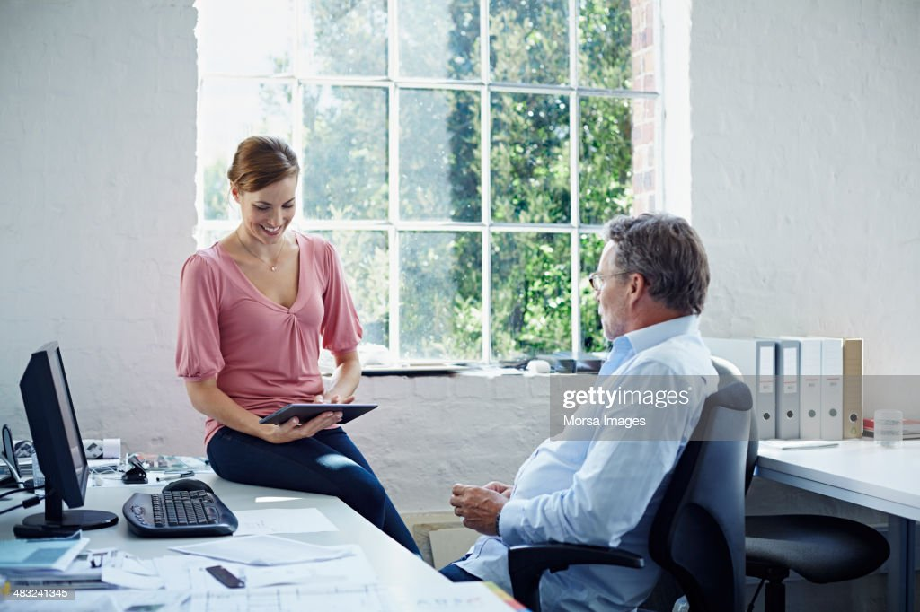 Coworkers reviewing results : Stock Photo