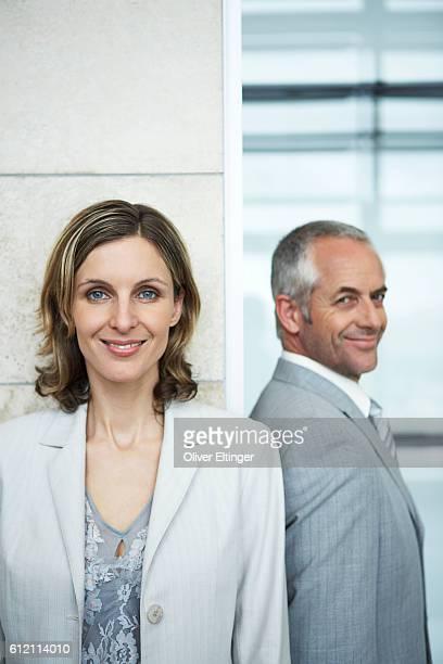 Co-workers standing shoulder to shoulder